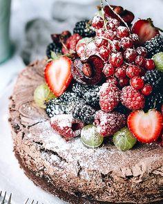 Chocolate Meringue Cake as a decadent vehicle for farm-fresh summer berries