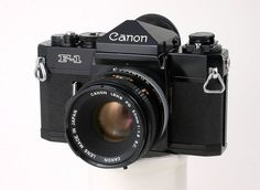Canon F1 1971 - The pilot model and flagship of the third generation of Canon SLRs. This was targeted at the professional market. With this camera Canon introduced the new FD lens mount. These offered motor drive, exchangable viewfinders, and other professional features.  These were semi-compatible with the earlier FL and R-mount cameras and vice versa.