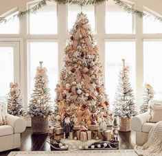 This white Christmas tree is decorated with white and light pink ornaments #whitechristmastree #decorated #lightpinkornaments