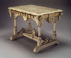 This is a Baroque style table that has an h form. It also has a lot of intricate carvings.