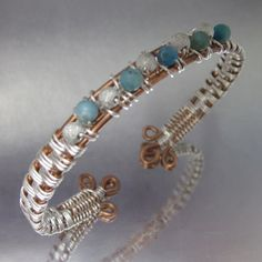 B_819_2 Handcrafted Solid 12 and 14 gauge copper wire bangle with silver basket weave and inter woven turquoise jasper and stardust sterling silver beads ea 4mm. Fits a 7 inch wrist.
