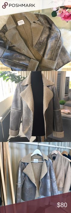 NWT Velvet Sherpa Metallic Jacket Metallic Sherpa Jacket - silver/ gunmetal finish. Tag reads that it can be reversible. Inner lining is a dark oatmeal. Excellent Condition Velvet Jackets & Coats