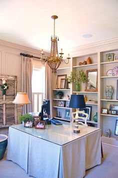 Katherine Connell Interior Design - home office, custom skirted table, bookshelves, @Currey & Company chandelier