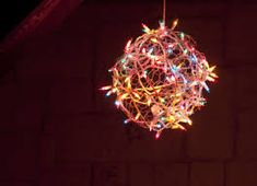Orb formed with chicken wire and mini lights.