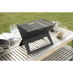 We love this folding grill for small patios, picnics and camping. Just fold it flat when you're done! Barbecue Grill, Grilling, Folding Bbq, Portable Charcoal Grill, Diy Grill, Grill Rack, Shops, Built In Grill, Cool Ideas