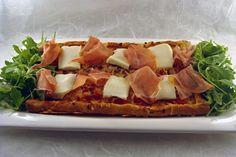 Junnekes recepten: Pizza met parmaham, mozzarella en rucola