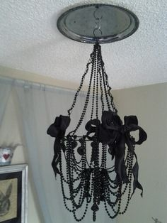 Diy chandelier cost under $30 made with stuff from the dollar store and yes I did make it myself. Lol