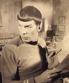 Quiet please...Spock is reading.          Watch out, new millennium heartthrobs!  Leonard Nimoy has been master of the smolder since the sixties!