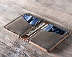 This listing is for one Leather Money Clip Wallet.  Personalized with the initials of your choice, this custom wallet will be displayed with pride for years to come. It's a great gift for groomsmen, boyfriends, husbands and fathers alike.  ————————————————————— [ PRODUCT FEATURES ] —————————————————————  ✦ Our signature hand-stitching ✦ Closed dimensions 4.75 by 3.25 ✦ Distressed leather (see below for complete details) ✦ Credit card pockets on both sides.  This money clip is meant to be…