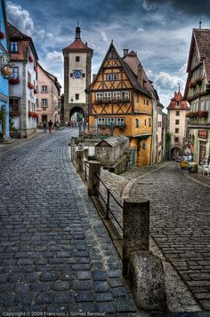 """Fairy Tale Town - Rothenburg, Germany  The yellow medieval house in the center is called """"Das Ploenlein"""".  I go to Rothenburg just about every time I go back to my native Germany. Lots of wonderful little stores and restaurants. My fave is """"Kaethe Wohlfahrt"""", a store for all things Christmas!"""