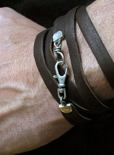 Simple and stylish leather braclet, but quite expensive for 50$ http://www.etsy.com/listing/97360852/mens-rustic-deerskin-leather-wrap?ref=shop_home_active