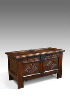 Charming little century oak coffer, with good wax patina. Double panelled top over a carved frieze and panels. Retaining the original hoop hinges. Raised on stile feet. Antique Bedside Tables, Antique Bedroom Furniture, Georgian Furniture, Antique Wardrobe, Wood Trunk, Antique Chest, Coffer, Miniature Crafts, 17th Century