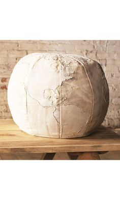 Sit on top of the world with the Canvas Globe Pouf. Covered in textural recycled canvas, this is sure to appeal to the curious and the bold in your home. When you're tired from your adventures, this pouf will provide the perfect place to relax and rejuvenate.