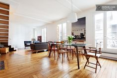 Apartment in Paris, France. Our flat is located on the fifth & sixth floors of a six-floor century old building. There's no lift but that's easy exercise. It's a duplex of 70m2 (750 sq ft) with two bedrooms, one bathroom (with bath tub and shower), one toilet, a kitchen, din...