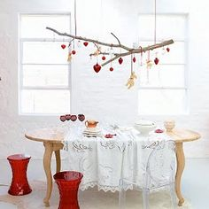 Love the idea of hanging ornaments off the branch. We already have a mobile with a branch with origami cranes.