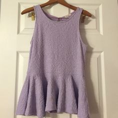 Purple peplum top Fun peplum top with a great texture! True to size, comfortable and easy to wear! Pair it with jeans or your favorite black skirt! Rarely worn, very nice condition  Francesca's Collections Tops Tank Tops