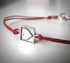 Sterling Boxed Love Bracelet on Red Linen from JewelryByMaeBee on Etsy.