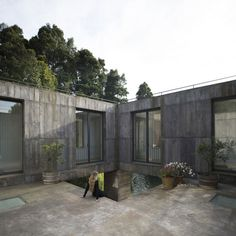 An open patio forms a focal point for the monolithic construction, around which the living spaces and bedrooms are located, all on one floor