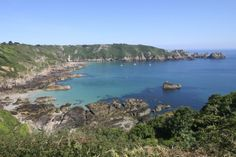 (PHOTO: Getty)  The UK's Most Beautiful Islands (according to Tripadvisor):  10. Guernsey, Channel Islands  It may only be 12 miles long, but what Guernsey lacks in size it makes up for in scenery. Britain used to fight with their French neighbours over this strategically placed island jewel, but nowadays the only battle you'll face is where to eat. An English fish and chippie or a Parisienne-style cafe, perhaps? Top tip: The Farmhouse Hotel and Restaurant, a four-star boutique hotel...