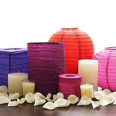 Arrange a few mismatched lanterns in the center of a table and place votive and pillar candles around them. Then sprinkle the surrounding table space with rose petals. Paper Lantern Centerpieces, Non Floral Centerpieces, Wedding Table Centerpieces, Paper Lanterns, Wedding Decorations, Centerpiece Ideas, Wedding Ideas, Centerpiece Flowers, Lantern Decorations