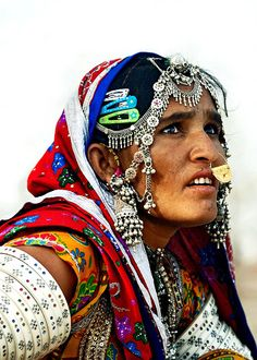Faces of India. She is a Mir tribeswoman who are a nomadic tribe living mainly in Gujarat, India.  Today some 10,000 Mirs live across western India and are involved in agricultural and construction work.  The women are expert in beadwork.