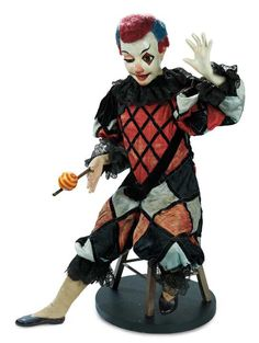 "French Musical Automaton ""The Juggling Clown"" by Vichy    30"" (76 cm.) A clown with highly-characterized papier-mache head is seated upon a wooden stool with one foot outstretched as though for balance,and his right hand clasping a wooden stick upon which he is juggling a ball. He has painted white clown complexion and painted clown decorations including one diamond-edged eye and a rosy nose tip,brown glass eyes,articulated eyelids,open mouth with painted teeth,wiry two-color clown hair,"