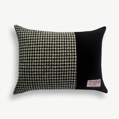 This 100% Harris Tweed Black & Houndstooth Block cushion by Memnia McWilliams will bring a touch of contemporary style and warmth to any sofa.