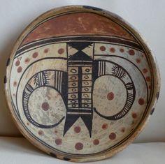 "A transitional Polacca polychrome bowl with a Sikyatki-revival ""eagletail""  design by Nampeyo, circa 1895"