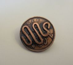 Handmade Antiqued Abstract Pin on a British Coin. by InnerCrows, $18.00