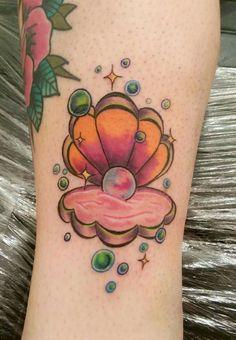 Clam shell tattoo
