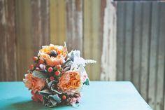 Peony wedding bouquet. dusty miller. Delaluz photos.  coral wedding bouquet  hypericum berry