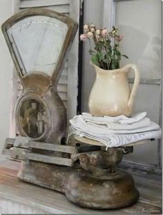 Old kitchen scales, linens, ironstone pitcher.