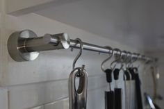 towel rack and for a bag of S hooks make a pretty inexpensive pot and pan storage unit. I was thinking curtain rod, but hand towel bars are better sized! Laundry Room Organization, Kitchen Organization, Kitchen Storage, Laundry Rooms, Kitchen On A Budget, New Kitchen, Kitchen Ideas, Kitchen Decor, Utensil Racks