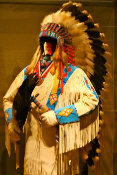 Traditional Native American clothing and headdress displayed at the National Museum of the American Indian by thepurplepassport, via Flickr