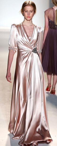 Jenny Packman. I would love to use this dress to make a pattern for a robe that would like kind of like this. LOVE!