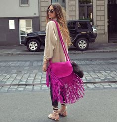 Try a more daring fringe with a colorful boho bag like the one carried by Maja from Maja Wyh's. See more of this summer's hottest boho bags here! #boho #handbags #bohobags