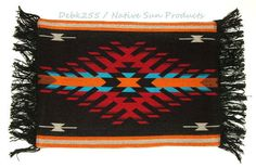 "This sharp looking geometric design woven placemat measures 13x19"" and has fringed ends. Fabric backed for durability. Just 7.95 ea w/ free shipping w/in the USA #homedecor #placemats #southwestern #black"