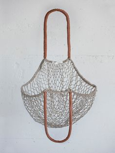// and so it goes. handwoven net & leather bag. via otherwild.