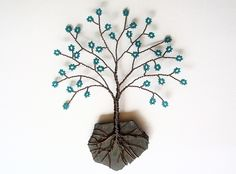 BEADED TREE OF LIFE: I like how the rock holds the wire roots.