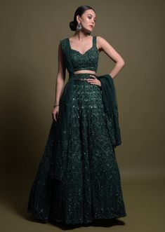 Bottle Green Lehenga Choli In Net Heavily Hand Embellished With Mirror And Cut Dana Work Online - Kalki Fashion Indian Gowns Dresses, Indian Fashion Dresses, Indian Designer Outfits, Designer Dresses, Green Lehenga, Indian Lehenga, Lehnga Dress, Blouse For Lehenga, Saree