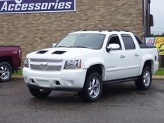 Chevy Avalanche with new grill insert, fender flares, chrome door handles and gas door, vent visors, lift, wheels. Chrome Door Handles, Escalade Ext, Vehicle Accessories, Chevy Avalanche, Fender Flares, Visors, Sexy Cars, Black Diamond, Pearl White
