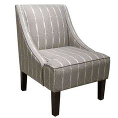 """Lattice-upholstered accent chair with pine wood frame. Handmade in the USA.    Product: Accent chairConstruction Material: Solid pine, fabric and polyurethane foamColor: Menton linenFeatures: Handmade in the USADimensions: 34"""" H x 22.5"""" W x 30"""" DNote: Easy assembly requiredCleaning and Care: Spot clean only"""