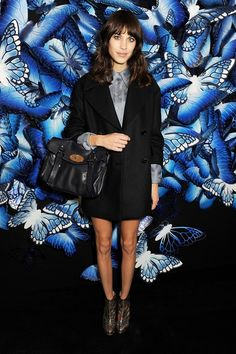 Alexa Chung wore top-to-toe Mulberry to attend the fashion house's London Fashion Week show - including one of her namesake Mulberry bags.