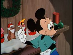 Mickey about to light the Christmas candle