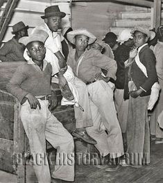 Pay Day 1939: A group of teens shown waiting in anticipation to get paid for working the cotton fields in Mileston, Mississippi, 1939