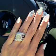 Loveeeee her nails... and that ring!o_o..amazing