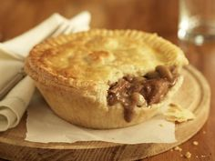 Make a delilcious Aussie meat pie filled with ground beef, onions and gravy and usually topped with tomato sauce (known as ketchup in the States).