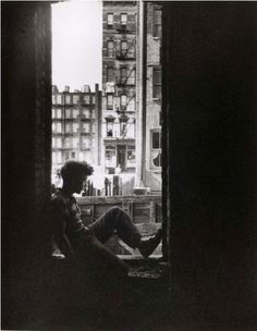 Arnold Eagle      Child in Window, New York City      1937
