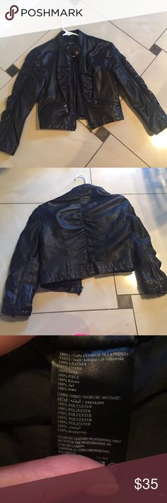 Bebe Black Leather Jacket 100% leather. No damage. It's s bit cropped and the sleeves are shorter too. Super cute to throw on for a night out. bebe Jackets & Coats