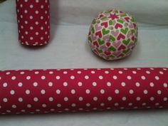 Long Bolster Decorative Pillows and Ball Decorative Pillow.